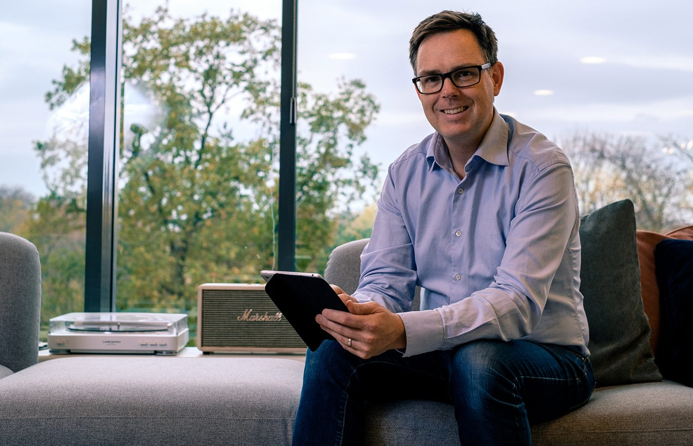 A man sitting in the office and using mobile device