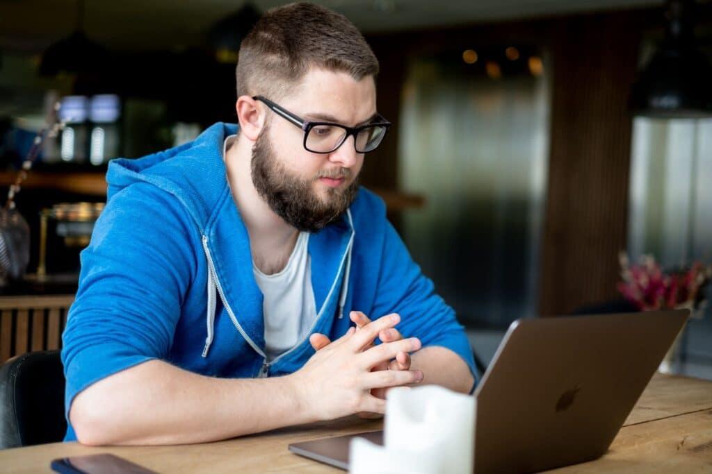 man sitting at computer learning